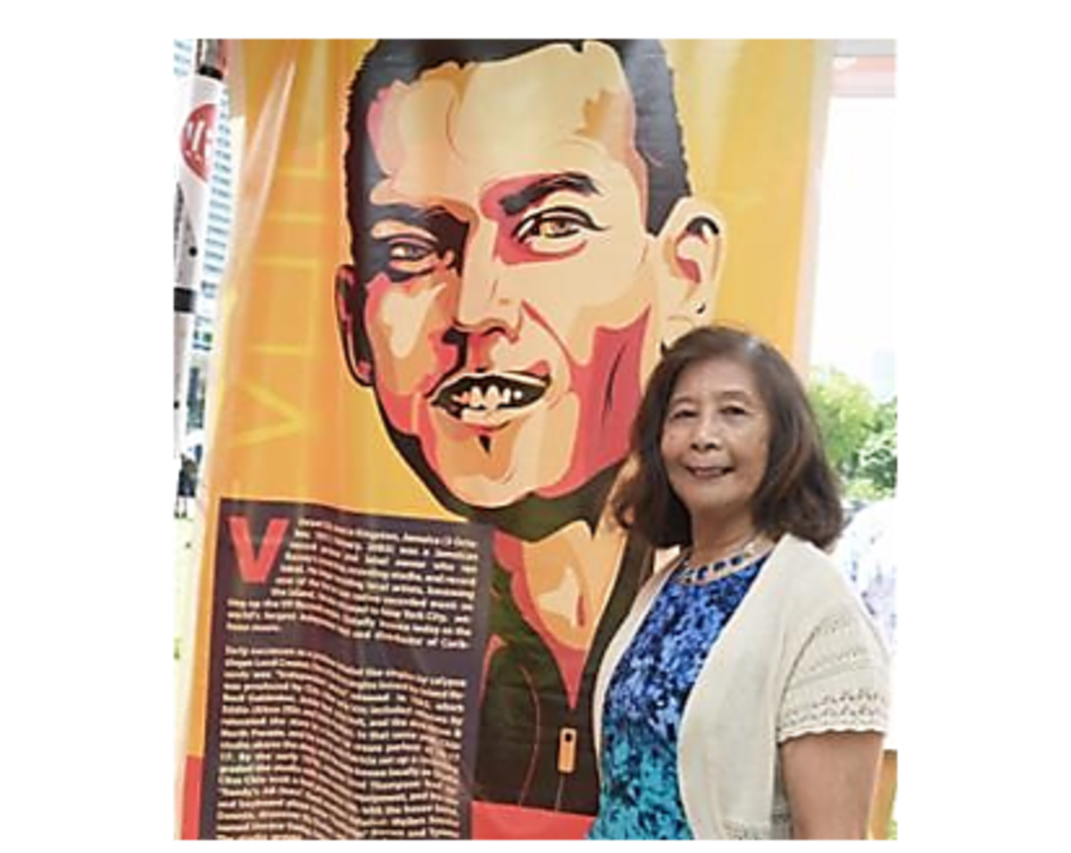 Patricia Chin with a poster of her late husband Vincent (2014)