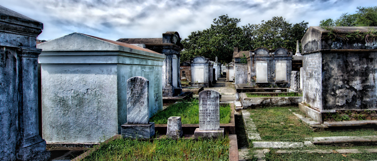 Many graves in Louisiana are above ground.  Crypts, tombs, and vaults hold the dead.