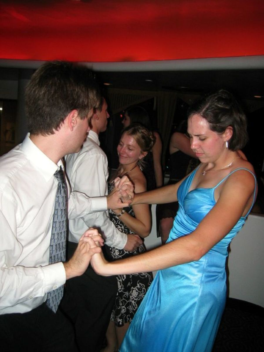 Hey, buddy, look at her body language.  It appears that she doesn't want to dance after all.
