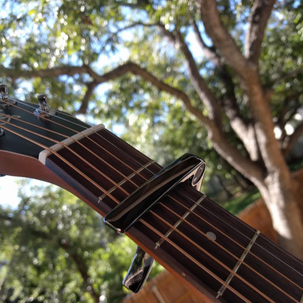 Capo on guitar.