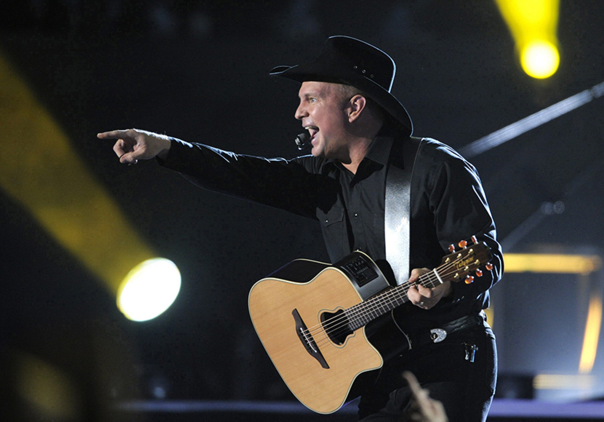 Garth Brooks on stage with his unique Takamine signature guitar.