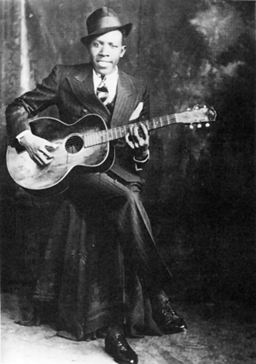 American blues singer-songwriter and musician Robert Johnson  Studio Portrait Hooks Bros., Memphis, circa 1935 ©1989 Delta Haze Corporation (fair use)