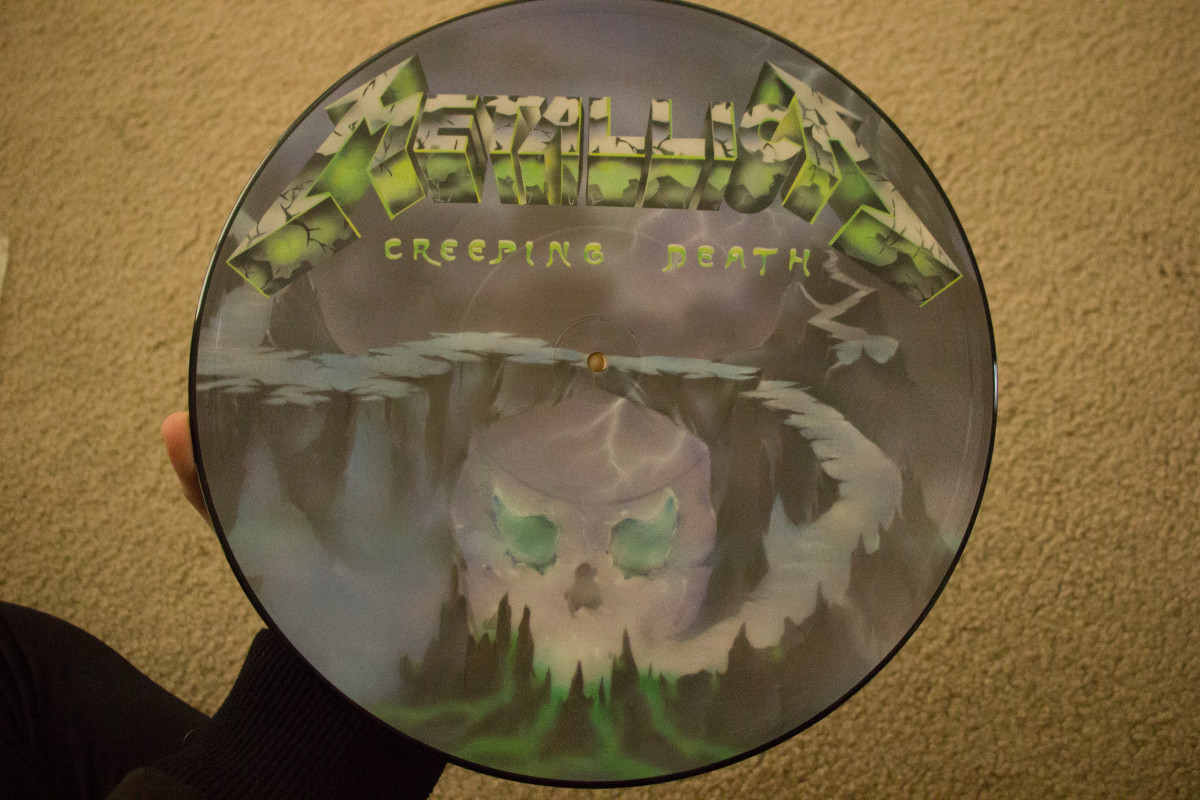 "A rare picture disk variant of the ""Creeping Death"" single from my collection. It sounds worn out but it still looks cool."