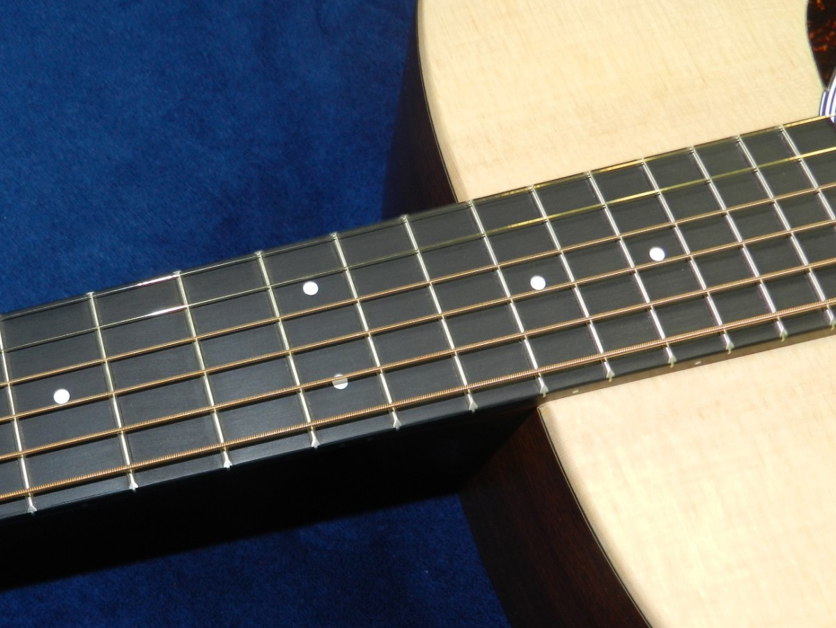 Check the neck, fingerboard, seams and joints when choosing a new guitar.
