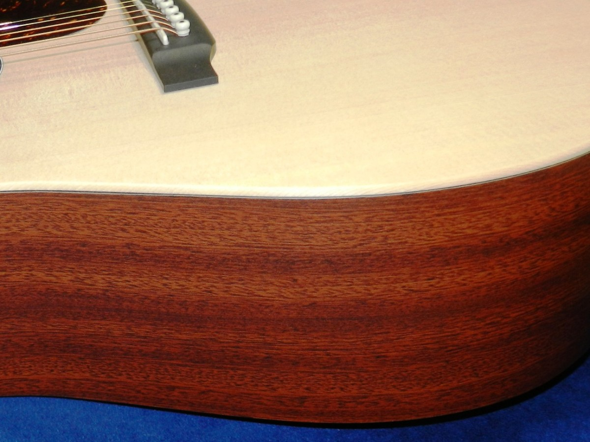 The Martin DX1AE utilizes HPL with a pretty mahogany pattern for the back and sides.