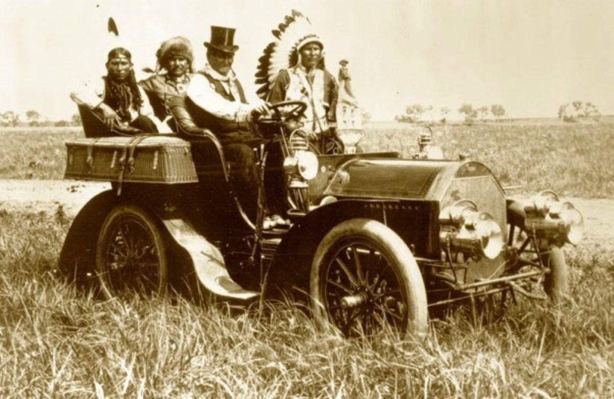 This 1905 vintage photograph of Geronimo dressed up in a suit and top hat, while riding a Cadillac inspired a great Western song.