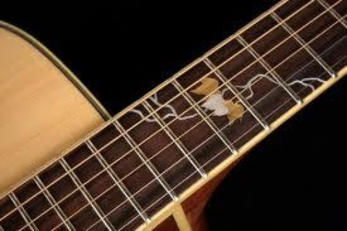 The beautiful fingerboard inlay on the Takamine 50th anniversary guitar.