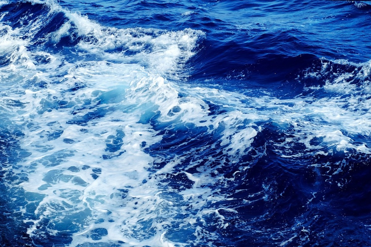 "Scientific American explains that ""the ocean looks blue because red, orange and yellow (long wavelength light) are absorbed more strongly by water than is blue (short wavelength light).""  It's all physics!"