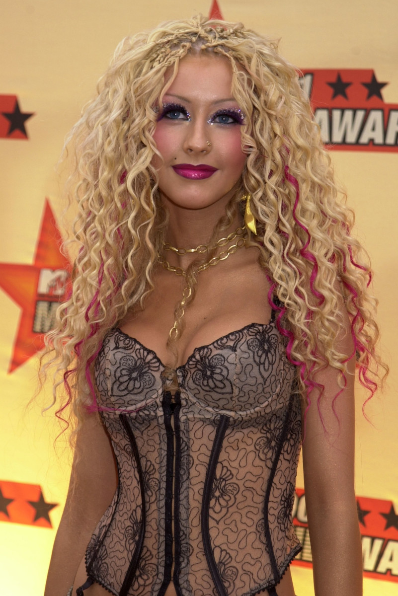 Aguilera rocking coiled girls and a corset at the 2001 MTV Movie Awards.