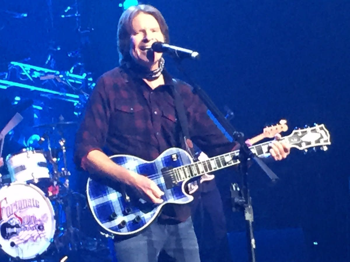 Fogerty and his blue plaid Les Paul Custom