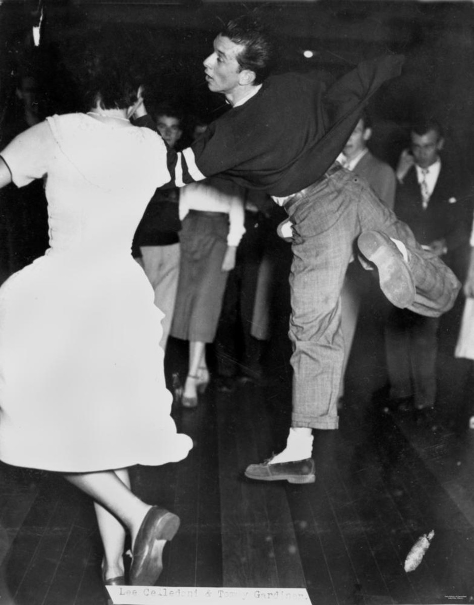 This fella is very light on his feet at this 1950 school dance.