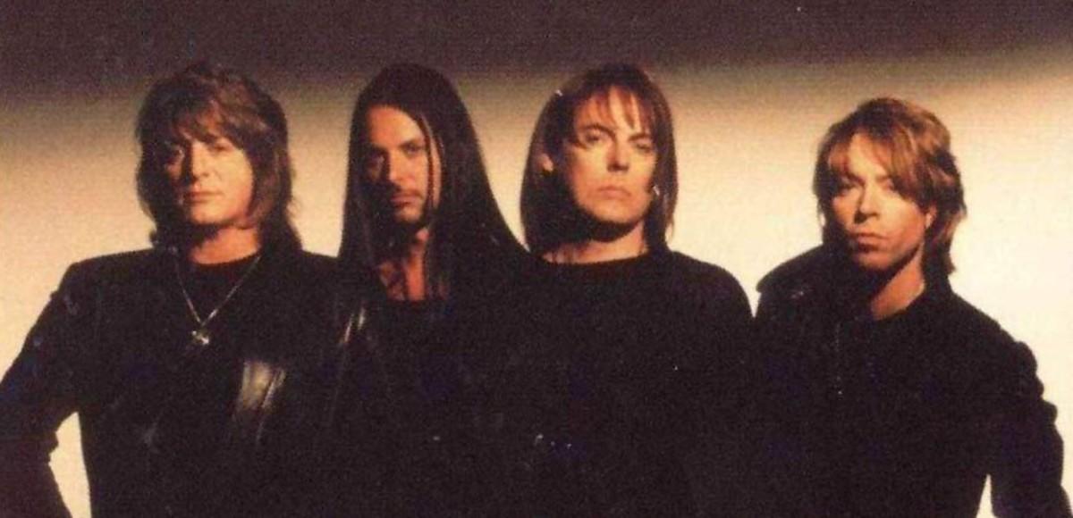 Dokken 1999, L-R: Mick Brown (drums), Reb Beach (guitar), Don Dokken (vocals), Jeff Pilson (bass)