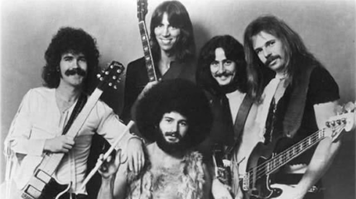 Brad Delp, Tom Scholz (standing), Sib Hashian (seated), Barry Goudreau, and Fran Sheehan.