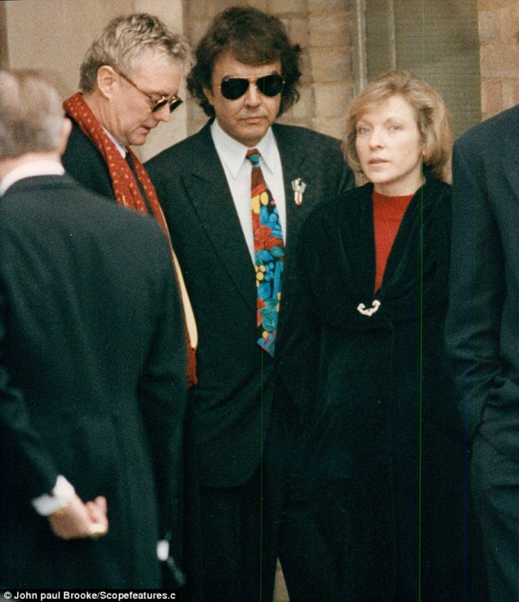 """Love of my life you've hurt me/You've broken my heart, and now you leave me""....Queen drummer Roger Taylor, Dave Clark and Mary at Freddie's funeral."