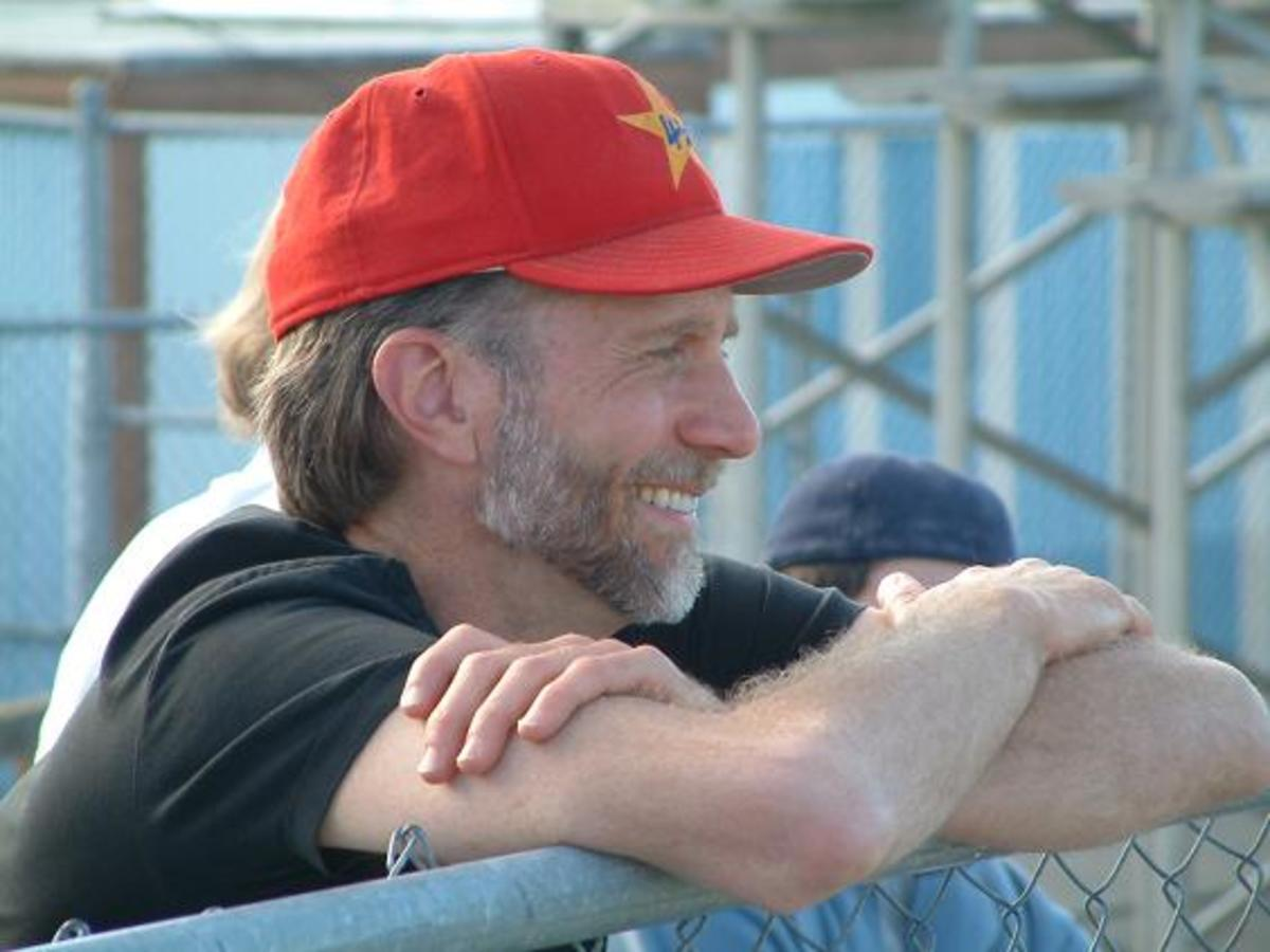 Photograph of Adams at a baseball game.