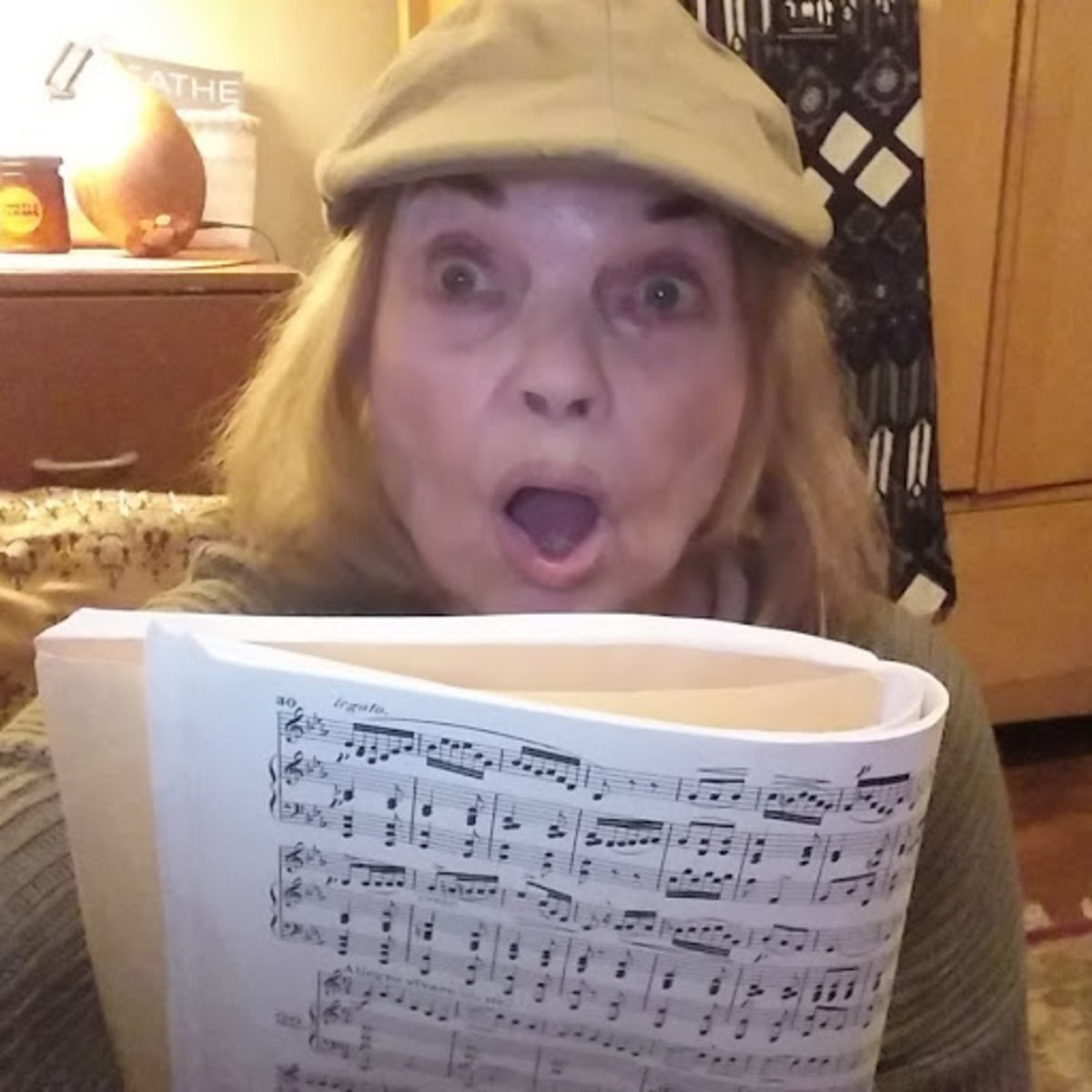 Author, in character, working on a new song for a musical production.