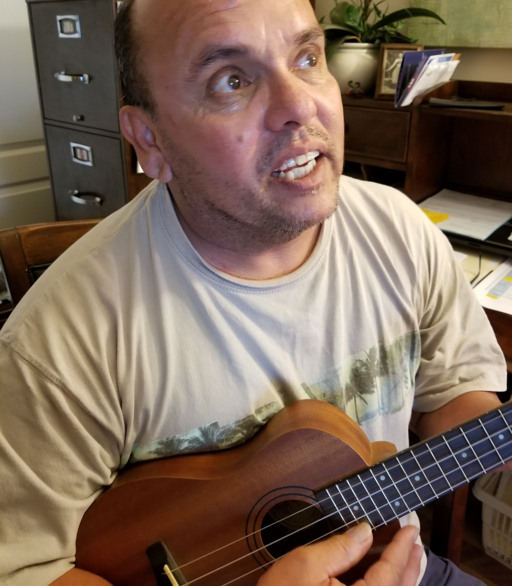 Singer, Jeff, singing along with his ukulele.