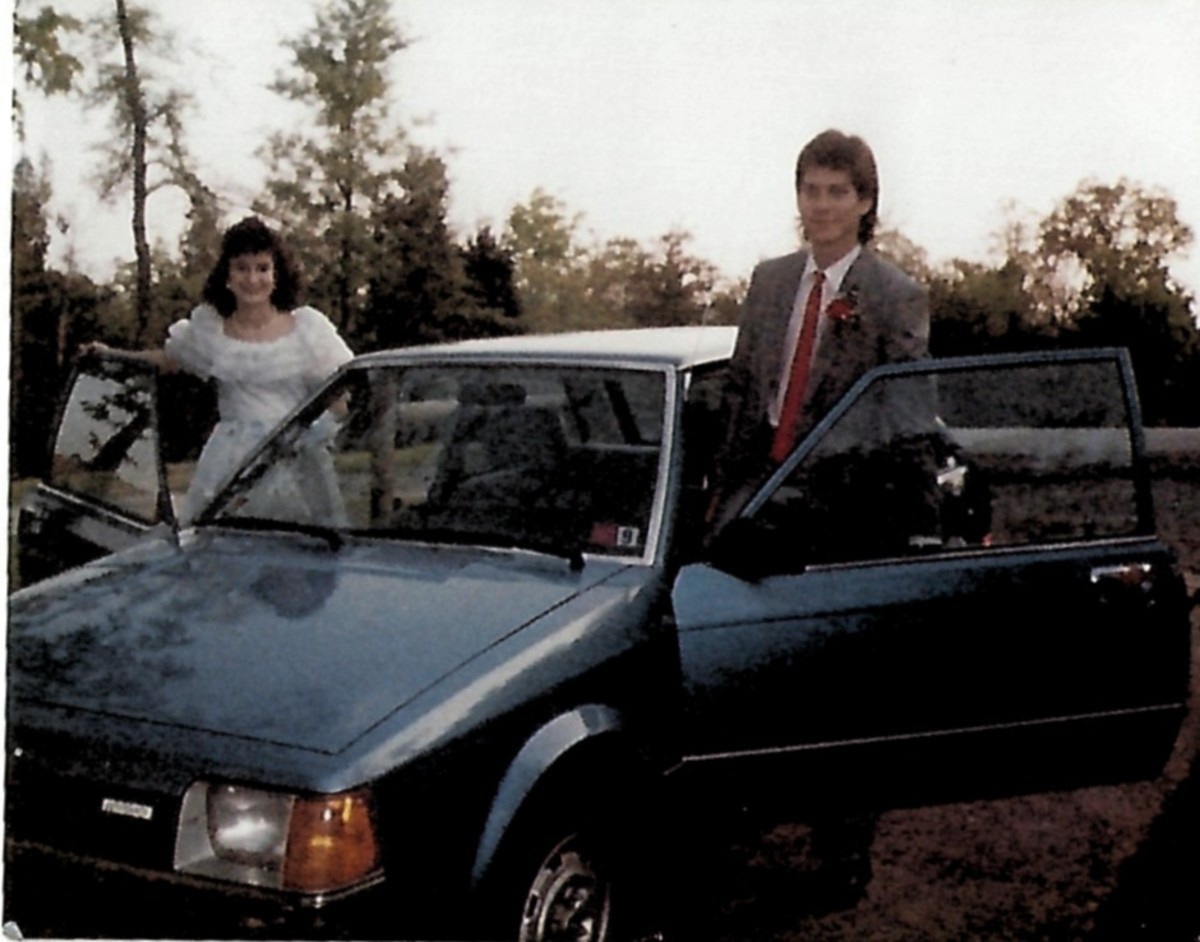 In the 1980s, cars were boxy, and men's styles (as modeled by my prom date) included thin ties and mullet hairdos.
