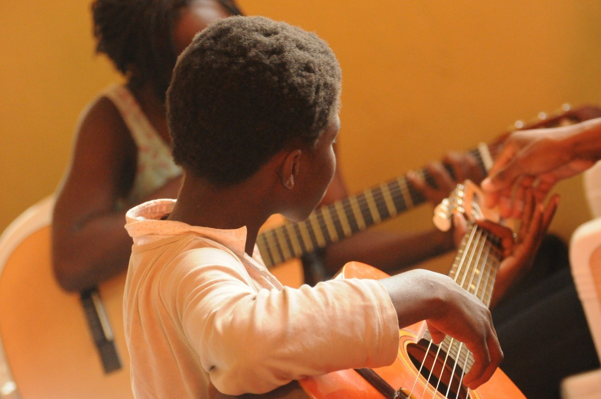 Children playing guitars