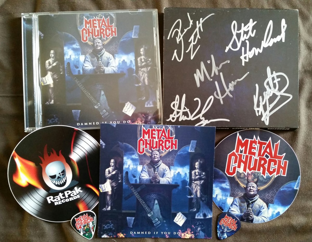 Autographs n' stickers n' guitar picks, oh my! Behold the Ultra Fanboy Pack!