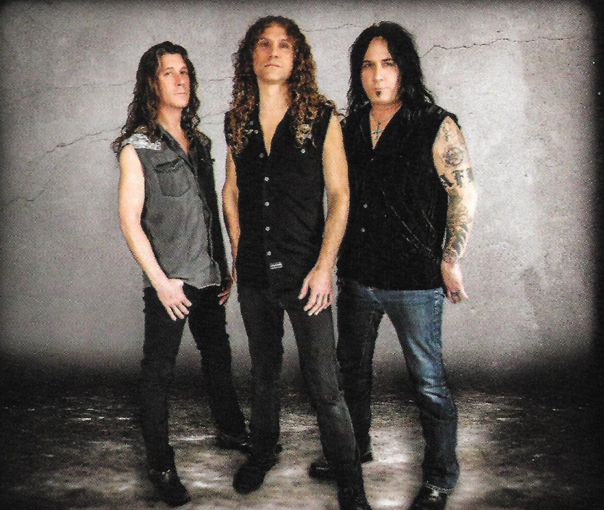 99 Crimes, L-R: Jeff Lynn (bass, vocals); Paul Lidel (guitar, lead vocals); Chris Jordan (drums)