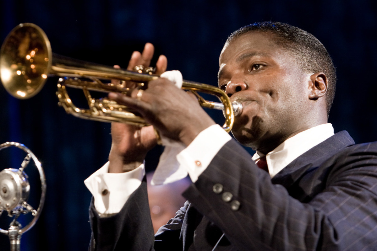 Reno Wilson as Louis Armstrong