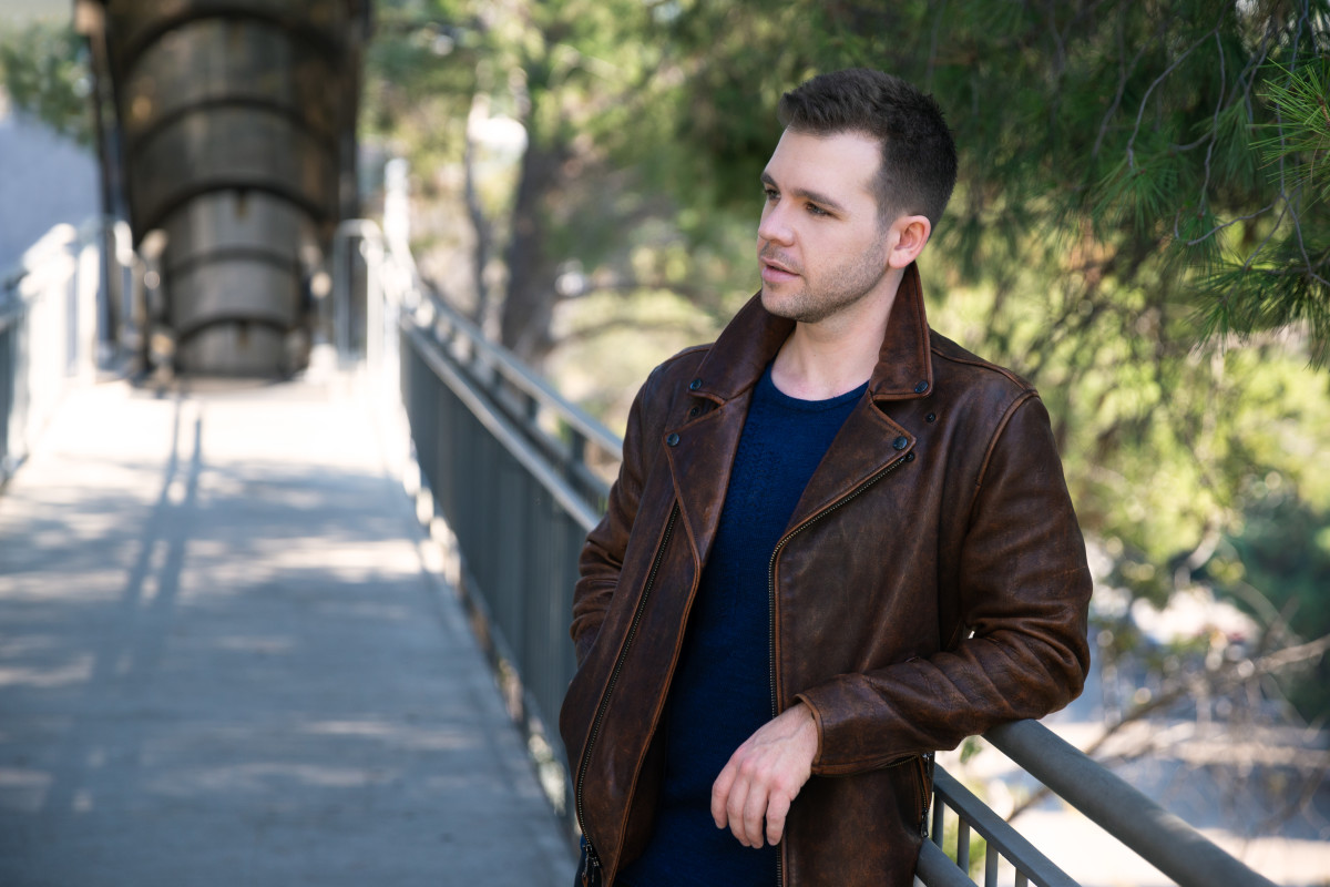 """Having lost a childhood friend to depression and addiction, Griffith Frank describes his song """"Reach Out"""" as a call to action for anyone facing a personal crisis too big to face alone. Esteban Calderón and Caitlin Timmins co-wrote the song with him."""