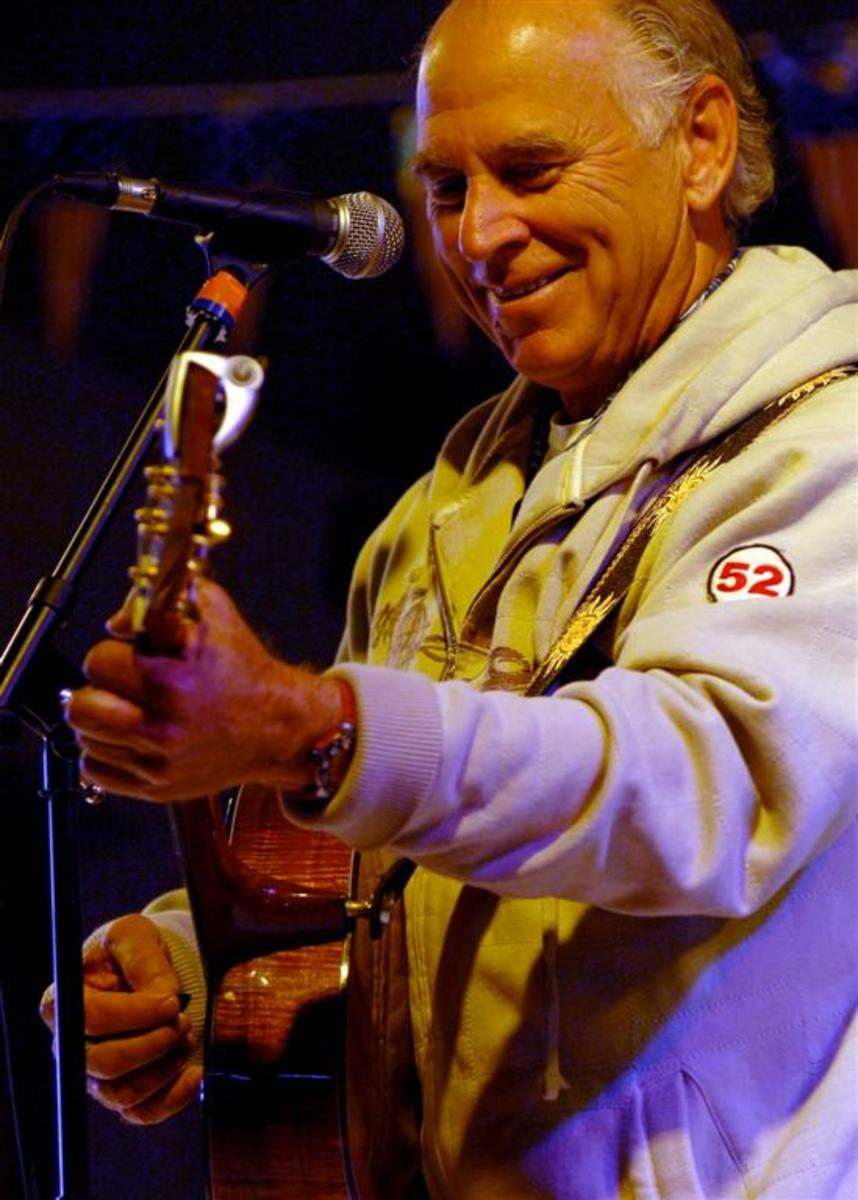 Jimmy Buffett performing a USO concert aboard the Nimitz-class aircraft carrier USS Harry S. Truman in January 2008.