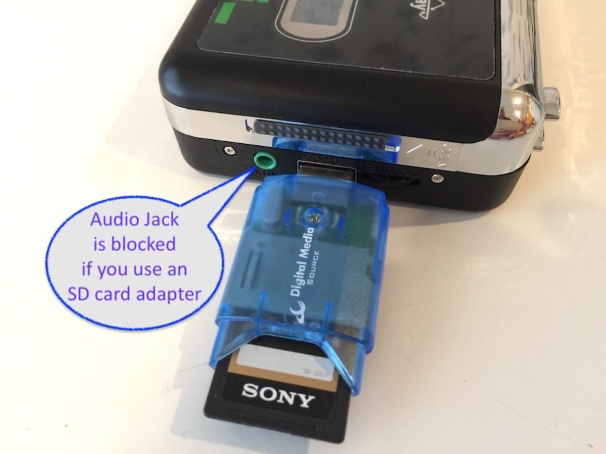 An SD Card adapter blocks the AUX audio jack.