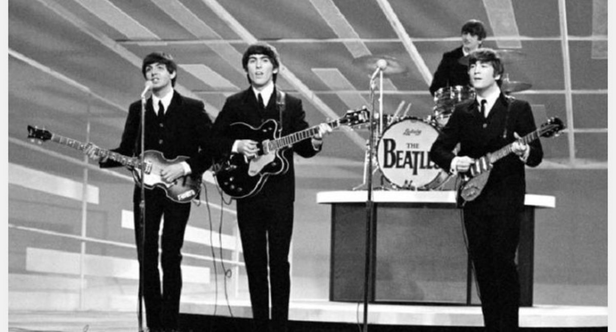 The Beatles performing for the first time at the Ed Sullivan Show in 1964