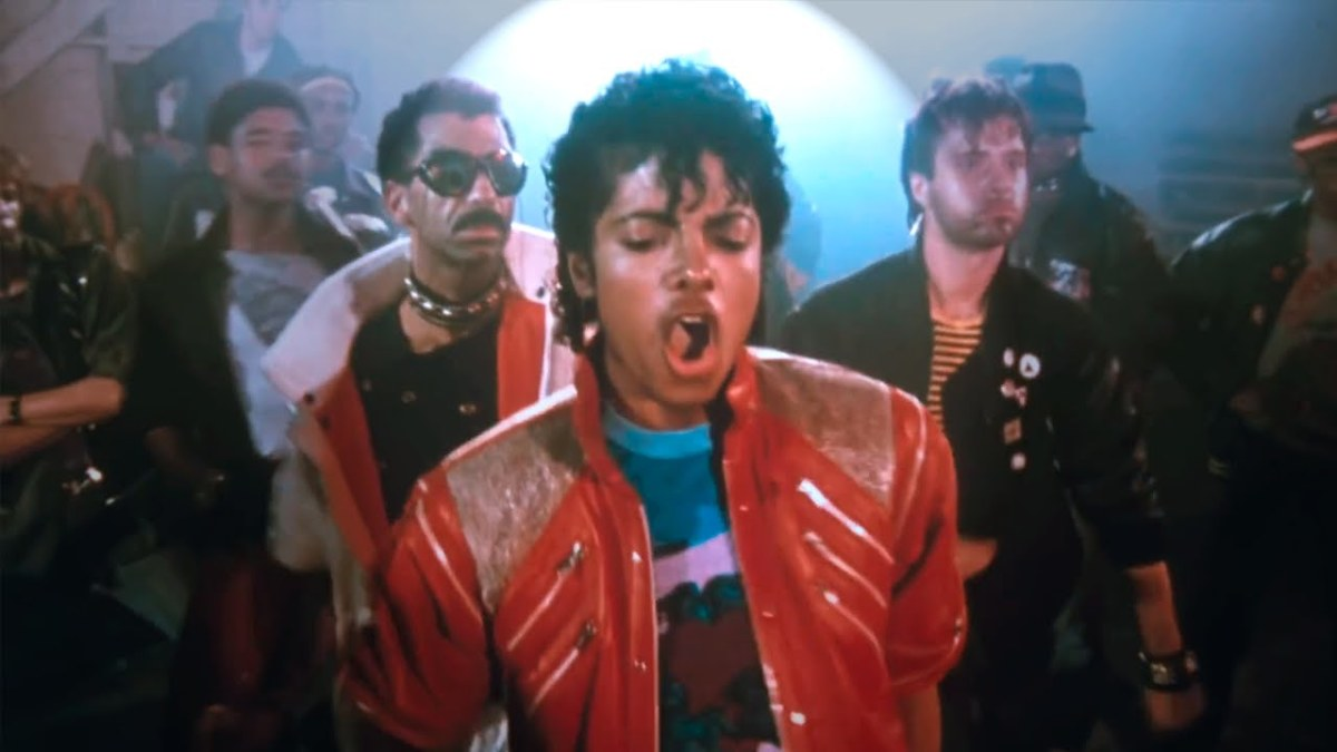 "Jackson during a dance step in the music video for ""Beat It."""
