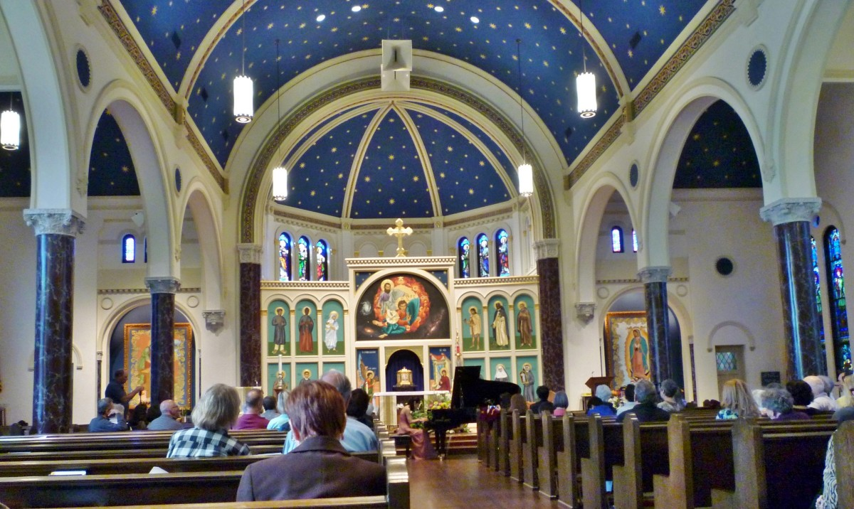 View from the back looking towards the altar inside of All Saints Catholic Church