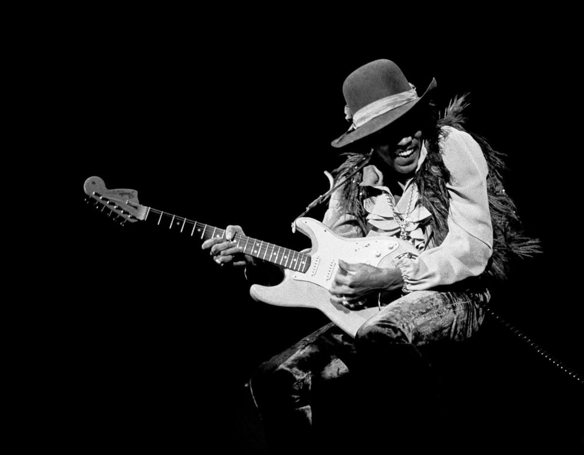Jimi Hendrix playing a guitar solo.