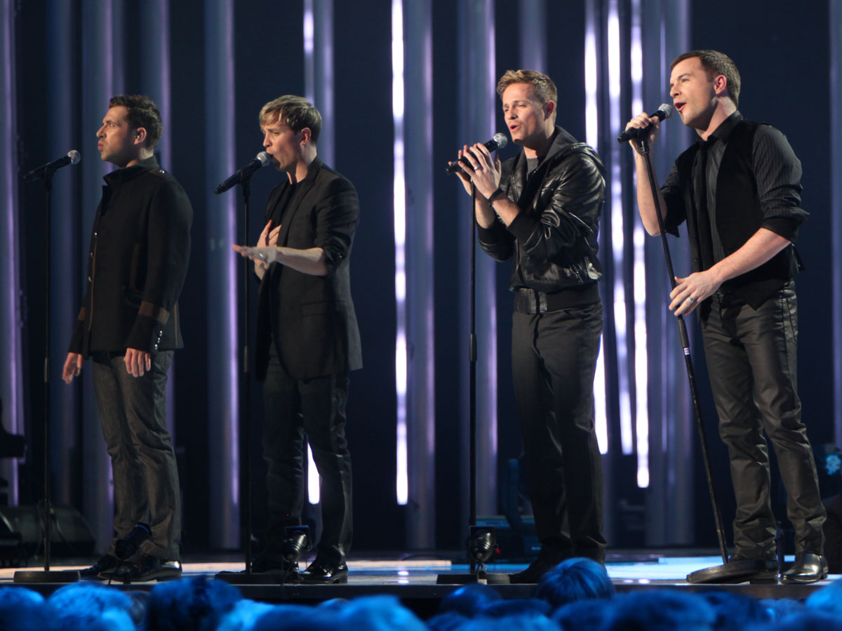 Boy bands often synchronize their outfits.