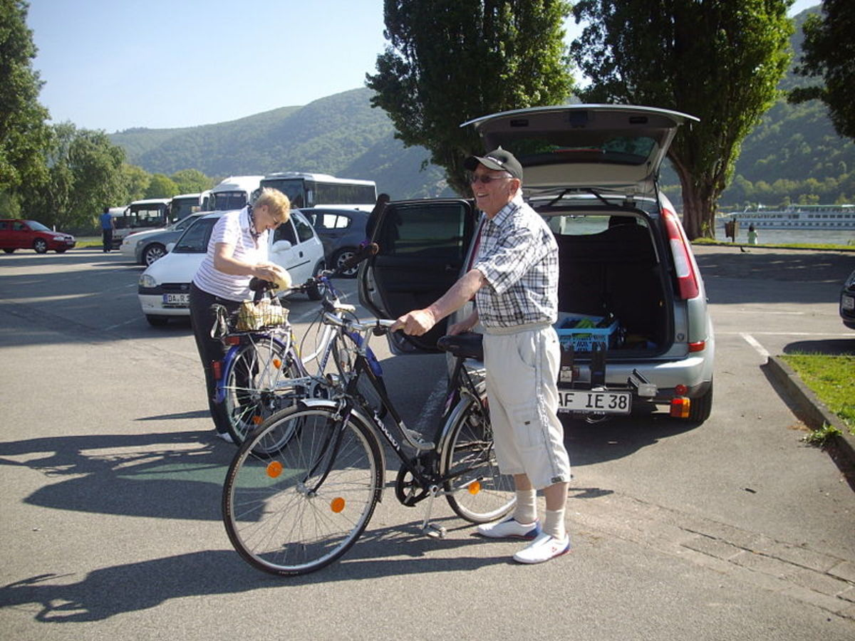 A couple on a cycling trek on banks of Rhine River(Germany)