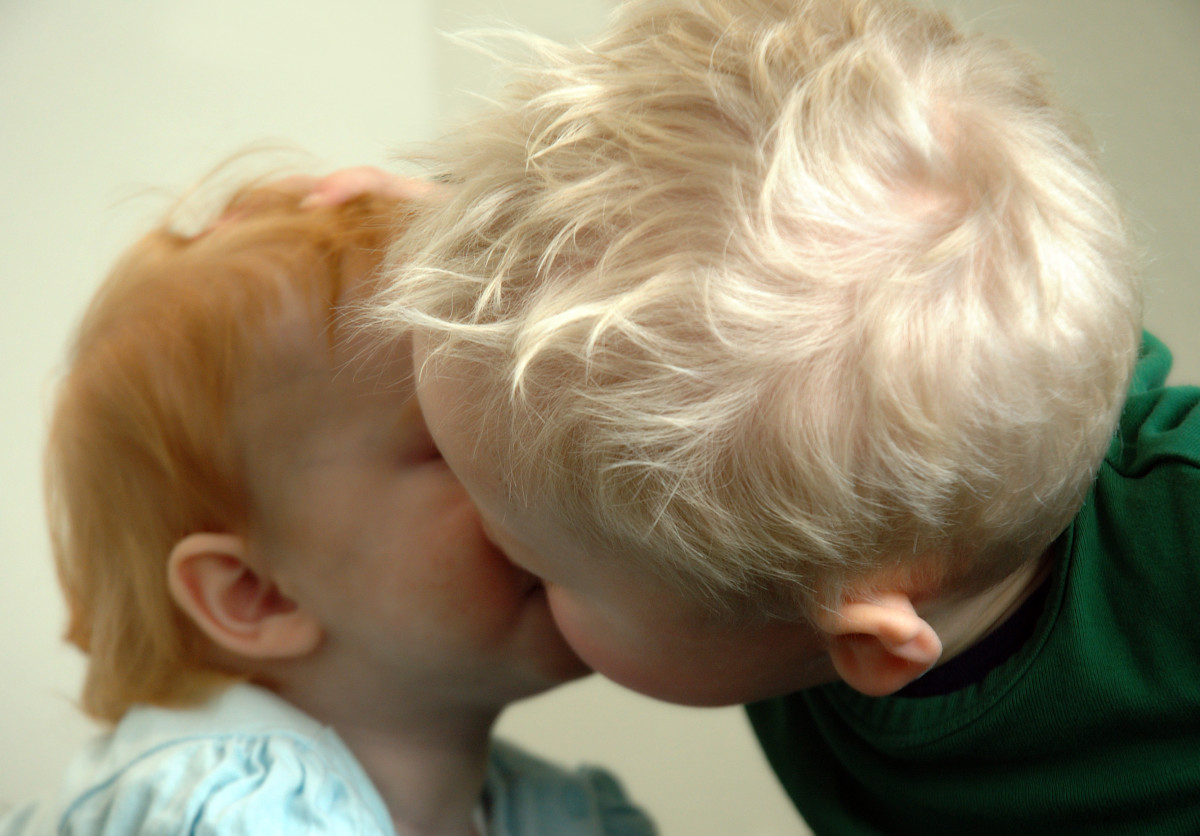 Some people kiss on their first date, but I think these two are a little young.