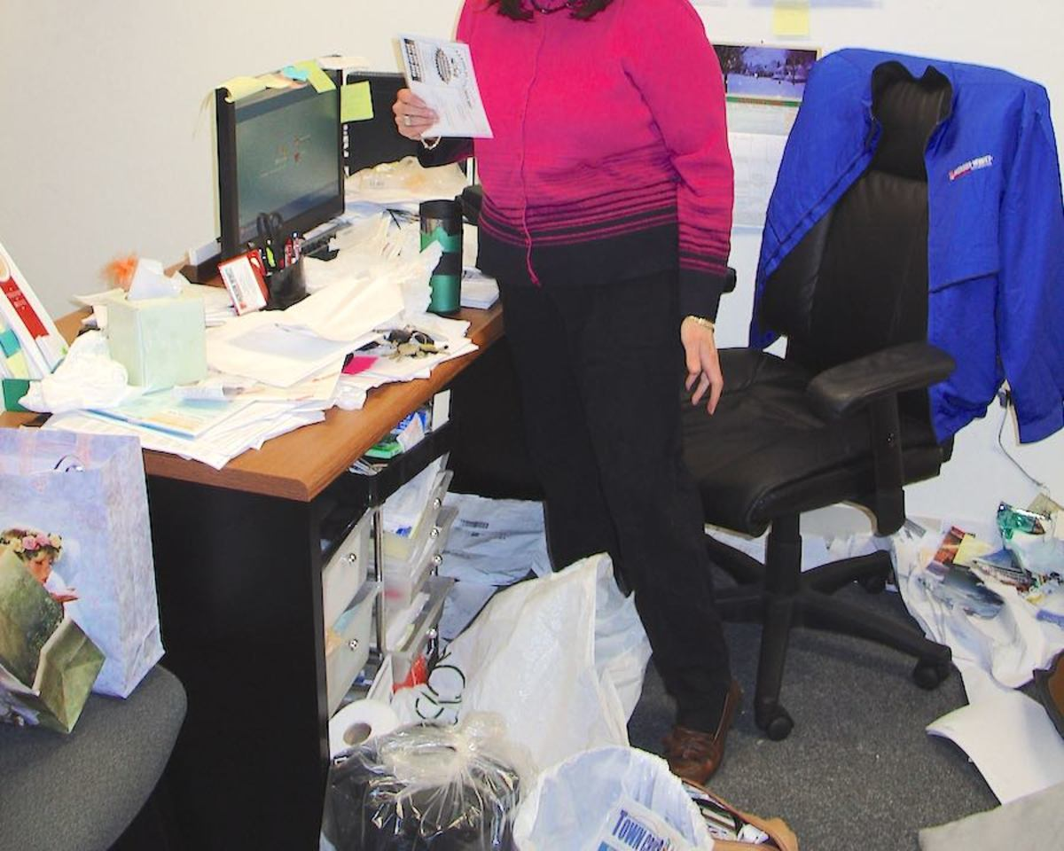 In denial that a cluttered office makes a poor impression.