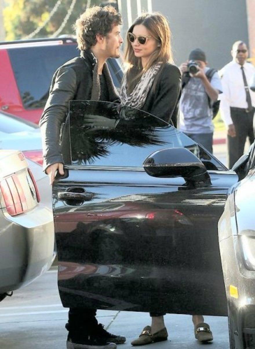 Orlando Bloom is the perfect gentleman as he opens the car door for his girlfriend and Victoria's Secret model Miranda Kerr.