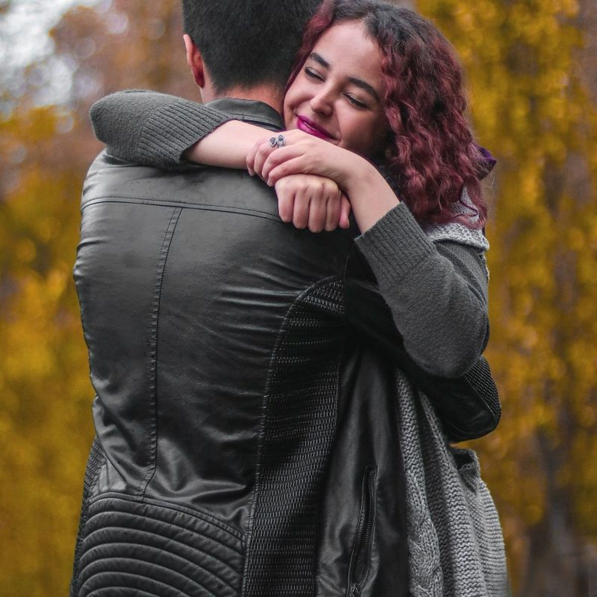 If you remain confident as you approach the girl you're hugging, she will be relaxed, and the situation won't be awkward.