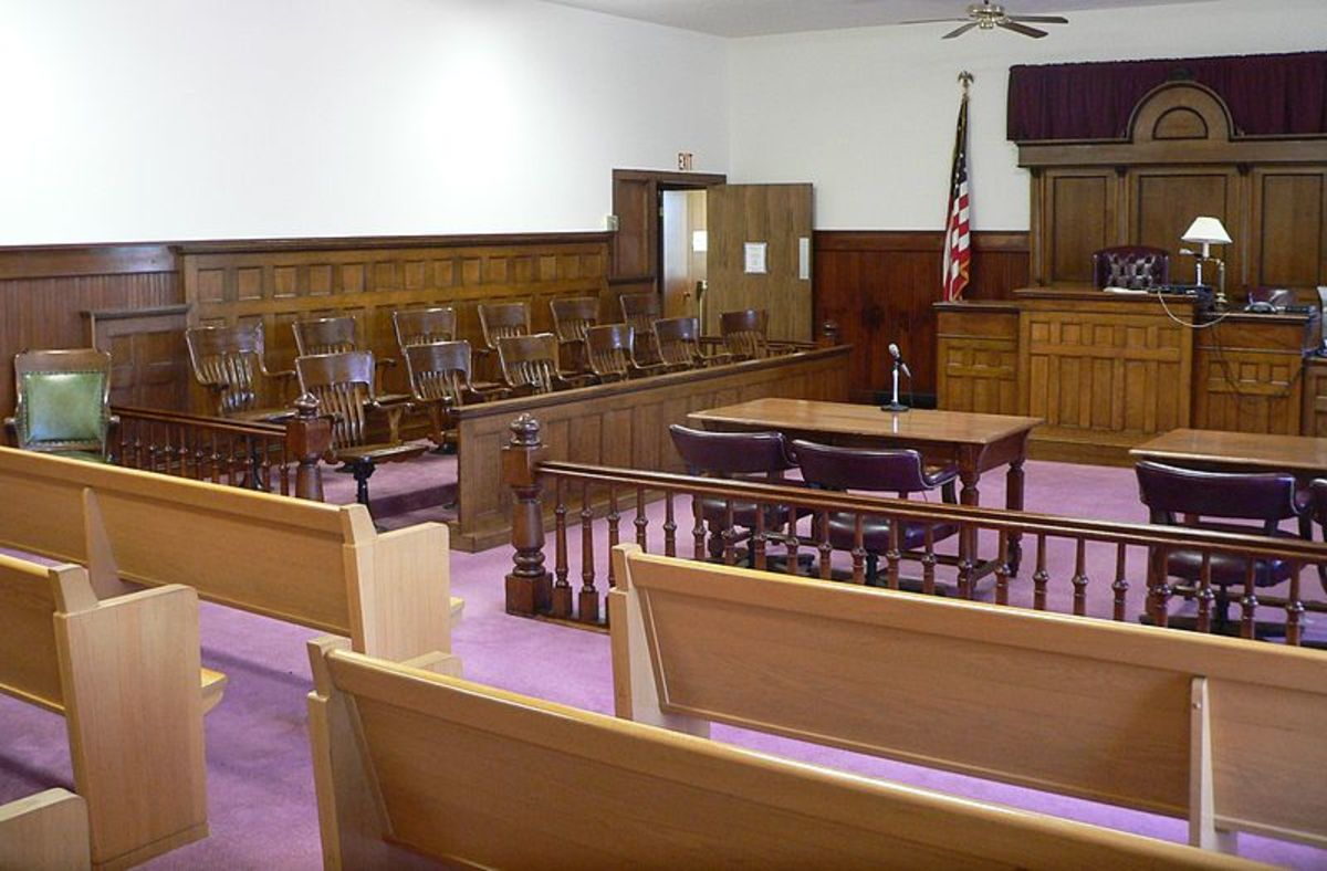 Facing the bench are seats for the public, but sometimes the proceedings are closed for uninvolved parties.
