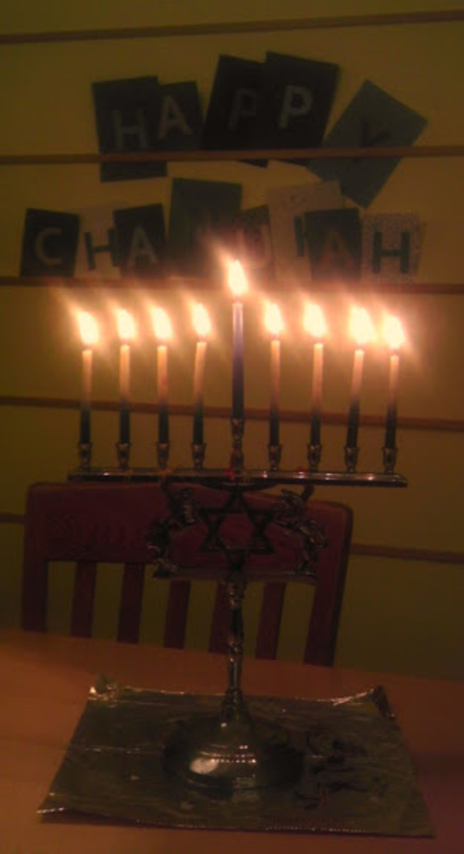 The author's Chanukah/Hanukkah banner lit by festive glowing candles.