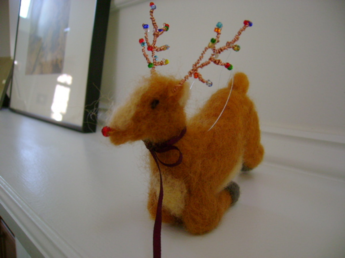 I used a bead to make Rudolf's red nose. (c) purl3agony 2012