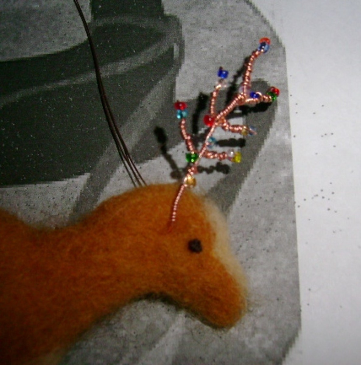 adding the beaded antlers  (c) purl3agony 2012