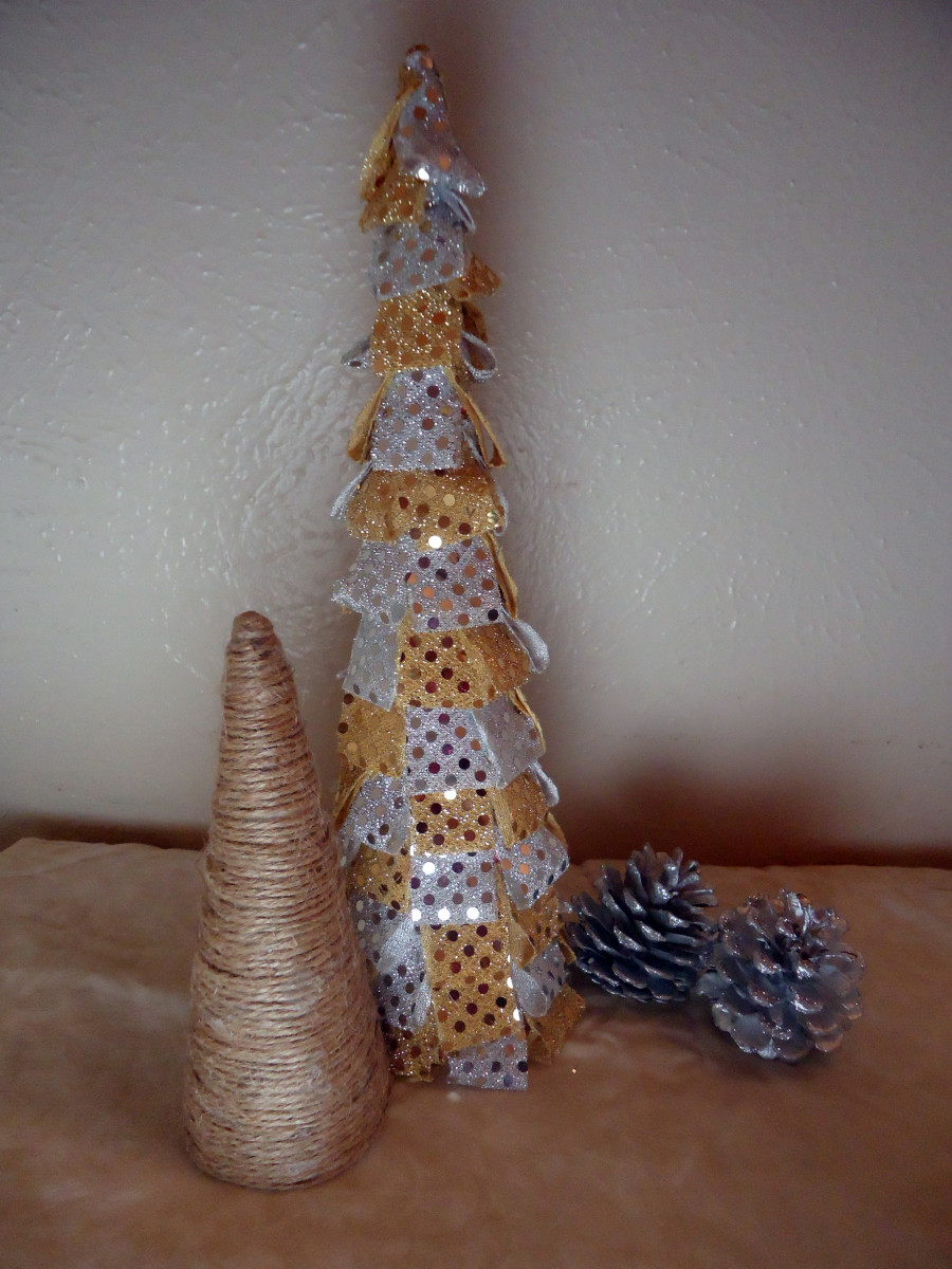 The short one is wrapped with jute and the tall one is covered with sequin dot material.