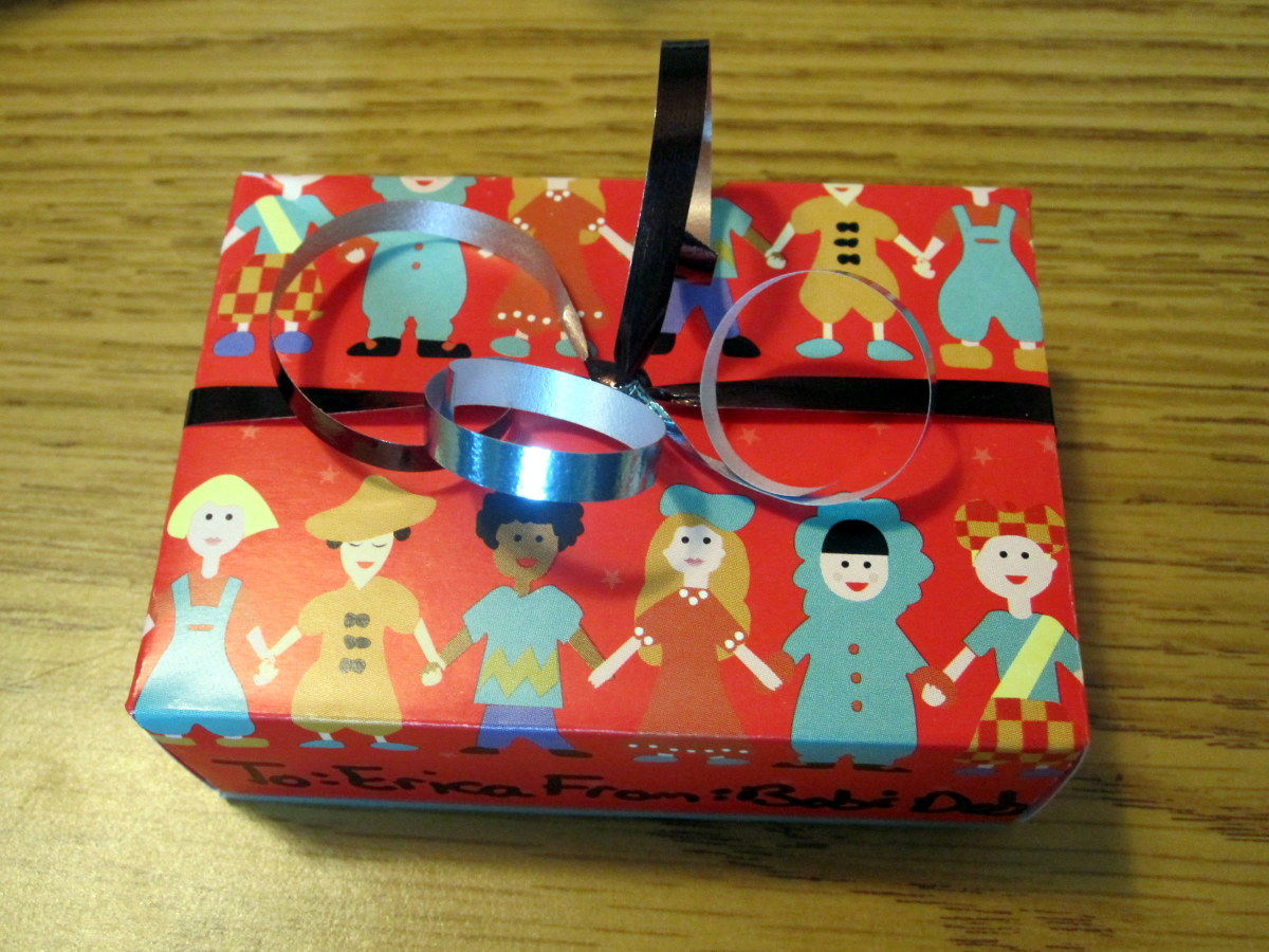 Repurpose old greeting cards into tiny gift boxes