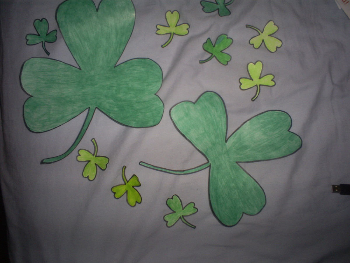 The colored in large and baby shamrocks are perfect for decorating windows and walls on Saint Patrick's Day.