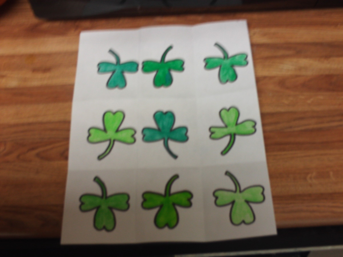 Color the little shamrocks before cutting these out.