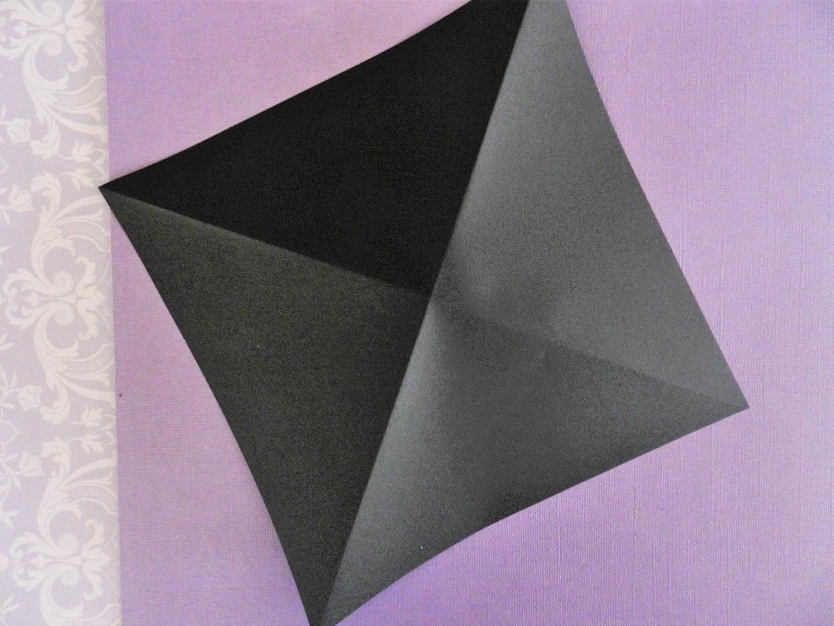 Fold square twice diagonally.