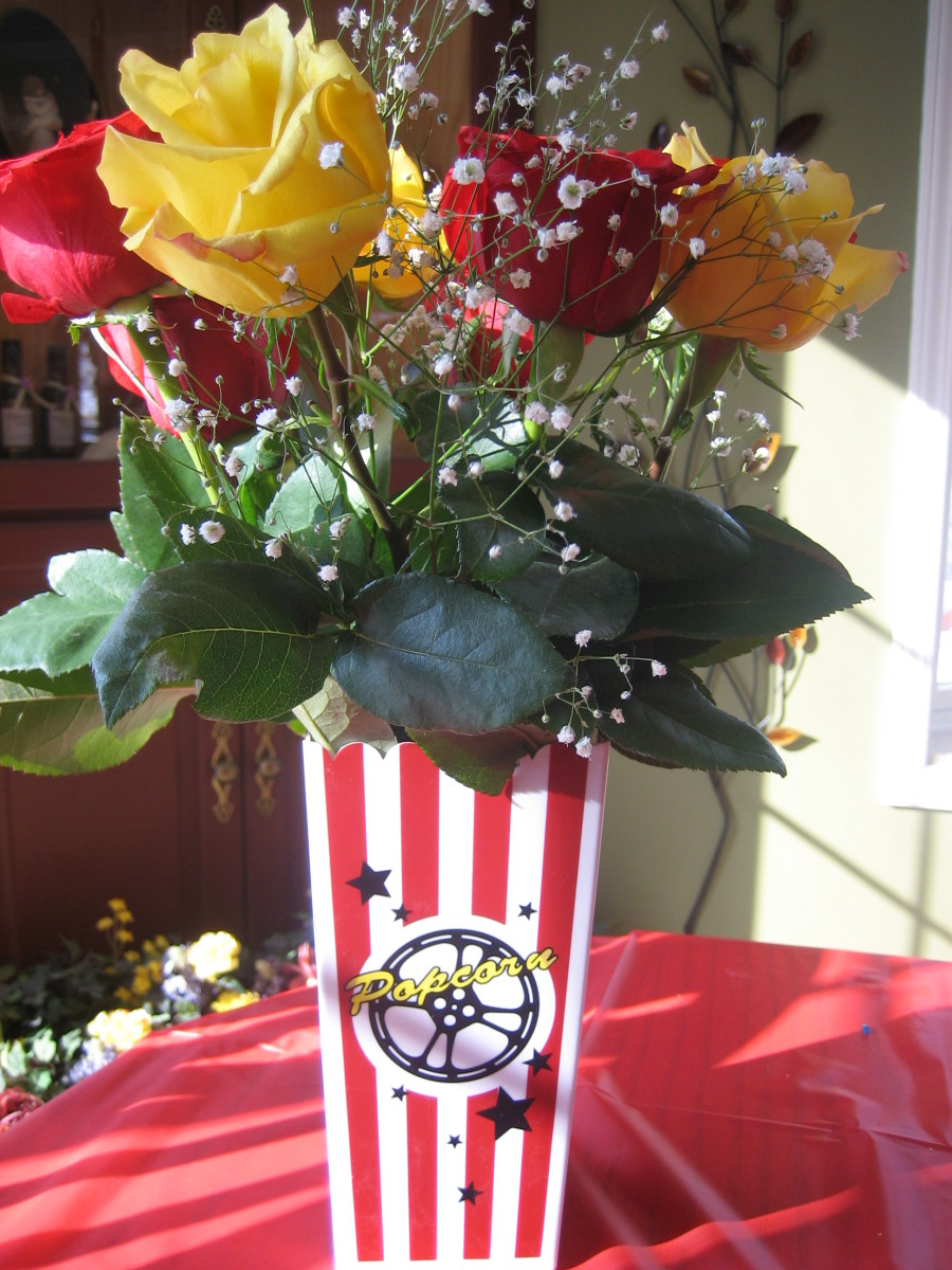 Roses in a popcorn container.