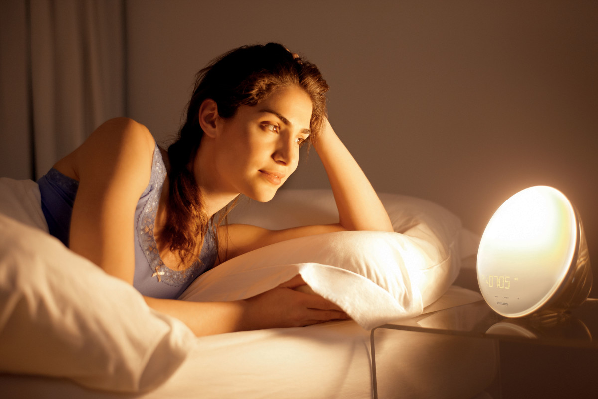 A wake up light that simulates sunrise and sunset can be a thoughtful gift for a woman who gets up early in the morning.